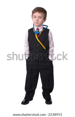 handsome attractive young boy dressed as a Doctor- in suit with stethescope looks off to his bright future on white background.
