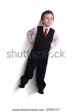 Handsome attractive young boy dressed in suit flying to a business deal isolated on white background.