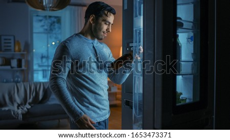 Handsome Attractive Young Man Came To the Kitchen in the Evening, Opened the Modern Fridge and Takes Out Bottle of Beer.