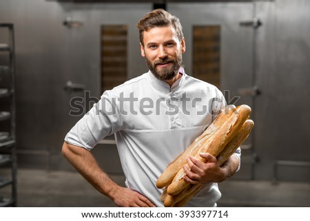 https://image.shutterstock.com/display_pic_with_logo/1619858/393397714/stock-photo-handsome-baker-in-uniform-holding-baguettes-with-oven-on-the-background-at-the-manufacturing-393397714.jpg