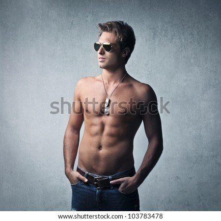 Handsome bare.chested young man - stock photo