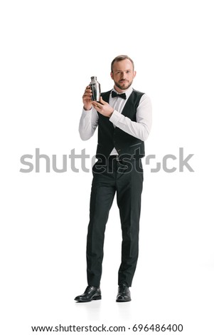 handsome bartender with classical metal shaker isolated on white #696486400