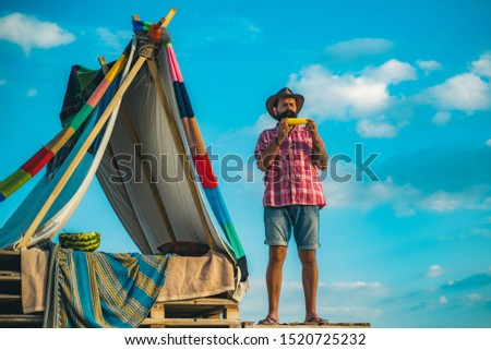 Handsome bearded man having fun in adventure Park. Travel recreational outdoor activity concept. Go Ape Adventure. Hovel decorated party #1520725232