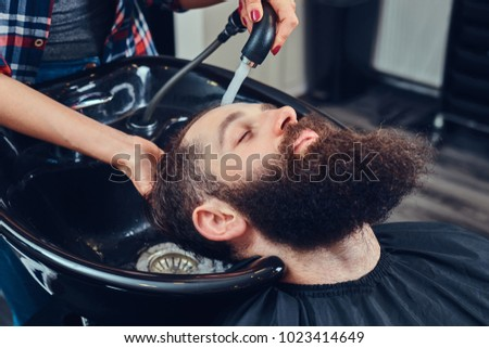 Handsome bearded man in the barbershop. #1023414649