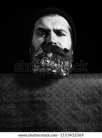 80080189d13 handsome bearded man or guy in winter hat with fashionable mustache on  serious face and red