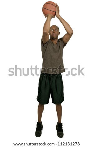 Handsome black African American man playing basketball