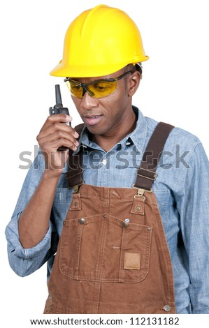 Handsome black man construction worker talking on a walkie talkie