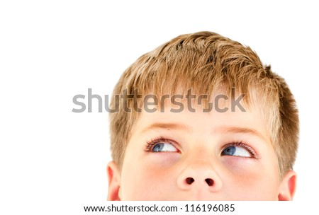 Handsome blond boy looking into the corner. Close-up portrait with copy space for text. Isolated on white.