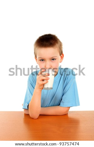 handsome blond boy with glass of milk isolated on the white background