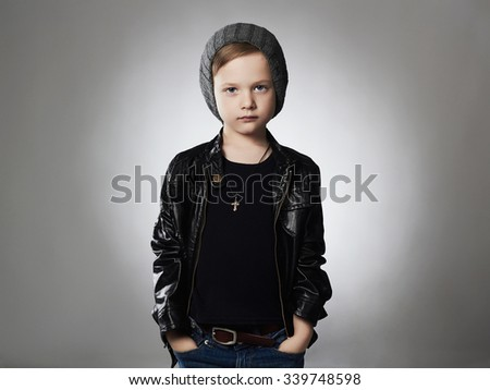 handsome boy.Funny child in hat.fashionable kid in leather coat.winter style