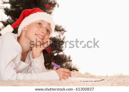 handsome boy write a letter on a white background