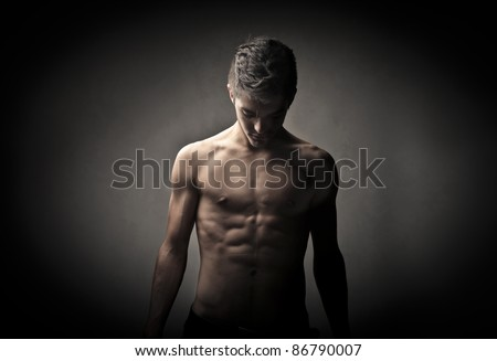 Handsome brawny bare-chested man