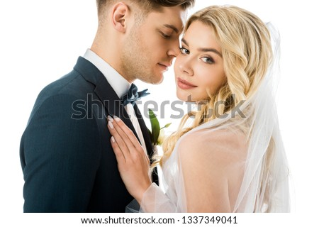 handsome bridegroom and beautiful bride standing face to face isolated on white ストックフォト ©
