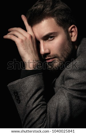 Handsome brutal man in gray suit cool hair style.Sexy Businessman. Confident, attractive, stylish. Fashion shooting. Actor. Stock photo ©