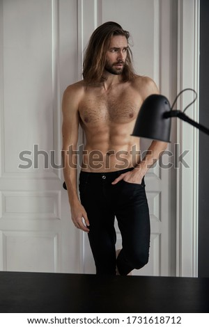 Handsome brutal man with beard and cool long hair.Sexy topless. Confident, attractive, stylish. Fashion shooting. Actor.