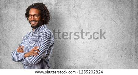 Portrait Of Happy Smiling Businessman In Crossed Arms Pose