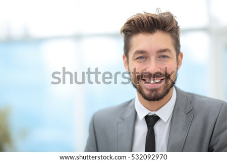 Handsome Business man in an office with blurred  background #532092970