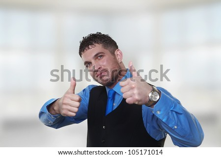 handsome business man looking happy with his thumbs up