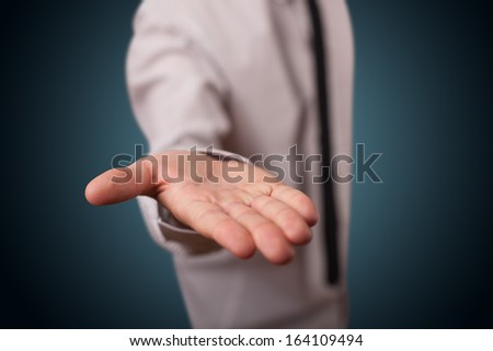 Handsome business man presenting with hand empty copy space