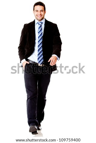 Handsome business man walking - isolated over a white background