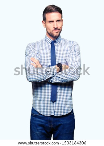 Handsome business man wearing tie skeptic and nervous, disapproving expression on face with crossed arms. Negative person. Сток-фото ©