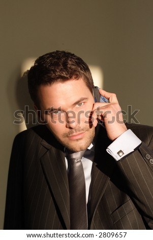 handsome business man with cellphone