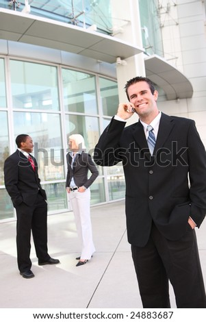 Handsome Business Man with team at the office building