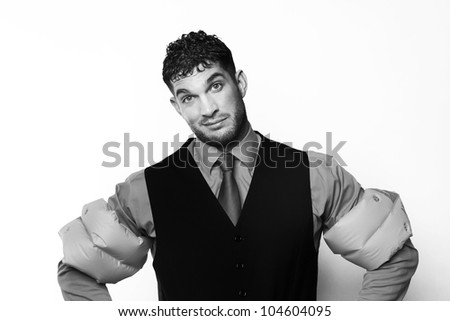 handsome business type man wearing rubber arm bands looking at the camera