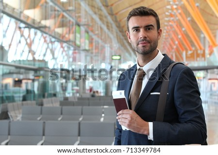 Handsome businessman at the airport with space for copy #713349784