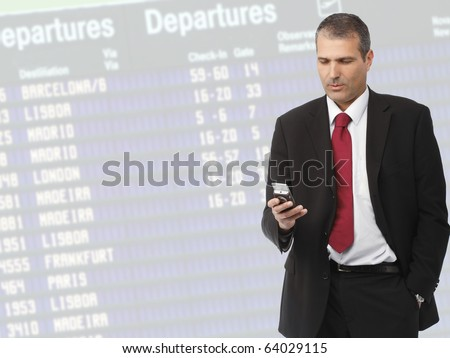 handsome businessman calling on mobile phone on airport