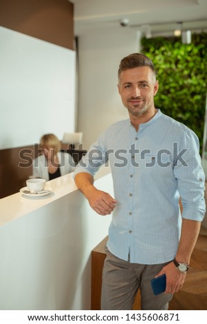 Handsome businessman. Handsome businessman wearing stylish shirt drinking tea before going to the doctor #1435606871