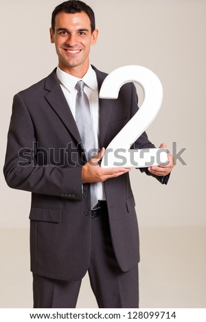 handsome businessman holding number 2