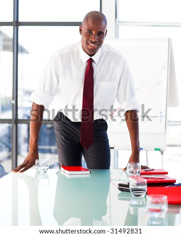 Handsome businessman in an office after giving a presentation