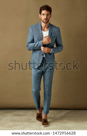 Handsome businessman in blue casual suit