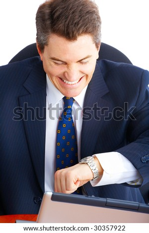 Handsome businessman looking at the watch - stock photo
