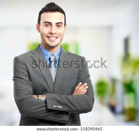 Handsome businessman portrait in his office