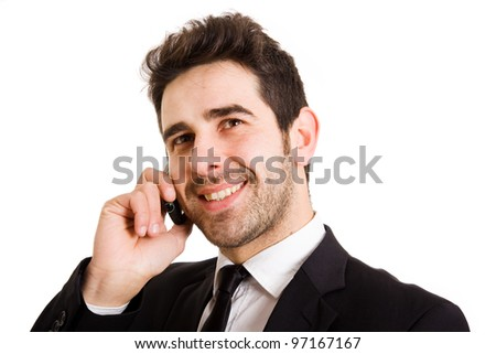 Handsome businessman portrait talking at the cell phone isolated on white background