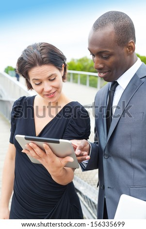 Handsome businessman presenting the project to her collaborator or client