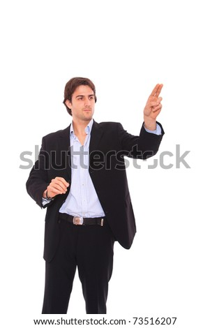 Handsome businessman pressing an abstract touchscreen button isolated on white