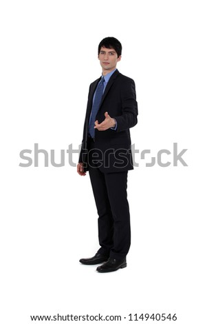 handsome businessman shaking hands with someone