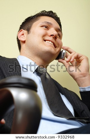 Handsome businessman sitting in his chair at the office