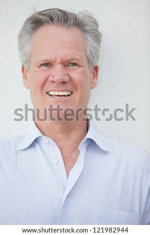 Handsome businessman smiling #121982944