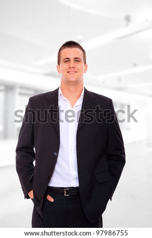 Handsome businessman standing at the office