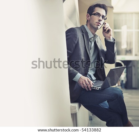 Handsome businessman talking over cellphone