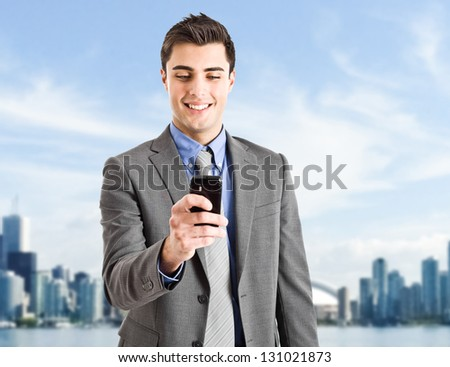 Handsome businessman using his cell phone