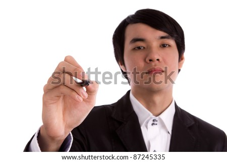 Handsome businessman writing something on glass board with marker