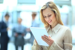Handsome businesswoman using his digital tablet