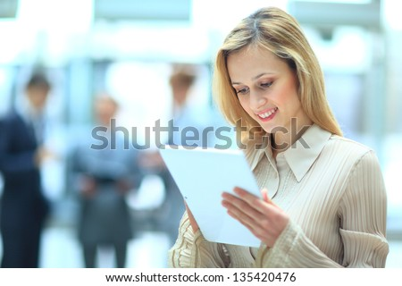 Handsome businesswoman using his digital tablet