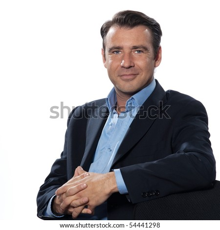 Handsome caucasian man businessman sitting relaxed portrait on white isolated backgroun