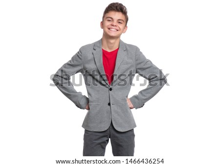 Handsome caucasian Teen Boy in suit isolated on white background. Teenager looking at camera. Happy child - close-up portrait.